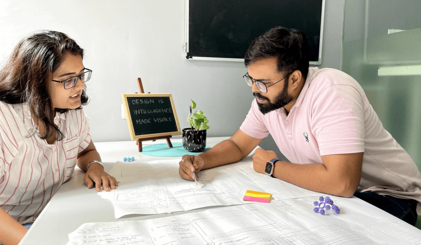 Aubergine UX/UI designers brainstorming ideas