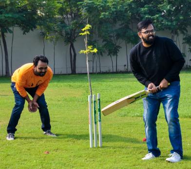 Aubergine members playing Cricket