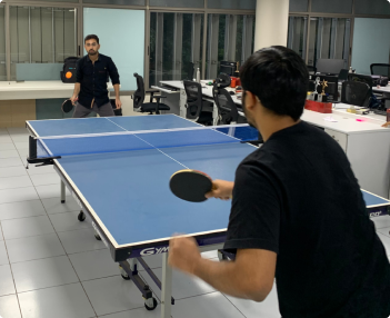 Playing table tennis at Aubergine office