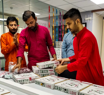 People celebrationg festival with Pizza box